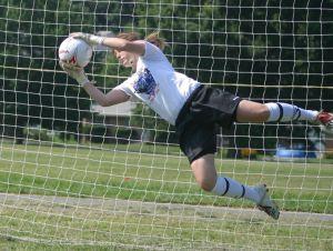 girl soccer catch